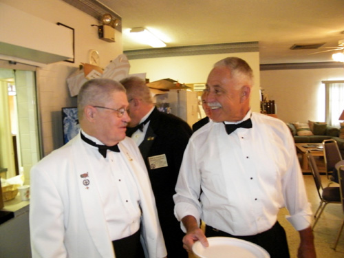 Two Past Masters sharing an insider-joke at dinner.